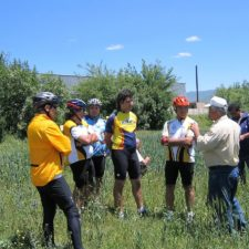 ATG Agro Tour Cyclists in Field with Gagik